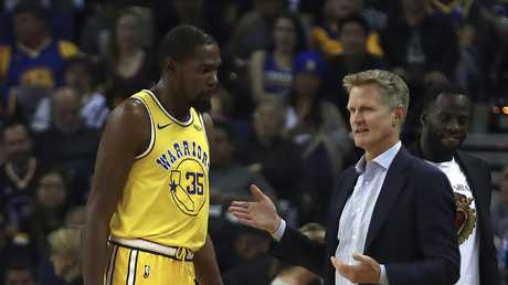 Golden State Warriors coach Steve Kerr, right, speaks with Kevin Durant. Picture: AP Photo/