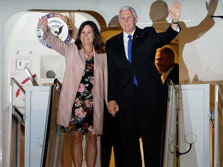 Mike Pence, with his wife Karen, is adamantly anti-abortion and favours churches in tax and education policy. Picture: Getty