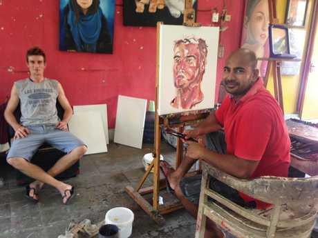 The late Myuran Sukumaran painting a portrait of Michael Czugaj inside Kerobokan Jail.