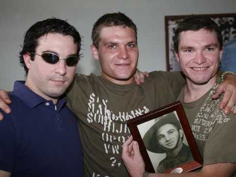 Scott Rush (centre) with his brothers during a birthday visit to Kerobokan back in 2006.