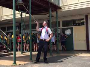 Year 12 students ring their school bell.