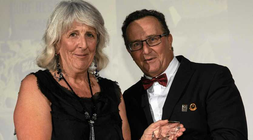 Cudgen Headland Surf Club member Jenny Kenny was named Surf Sports Official of The Year at the SLSA National Awards of Excellence held at the Art Gallery of NSW. She is pictured being presented with her award by Advisory Chair of Sport Andrew Buhk.