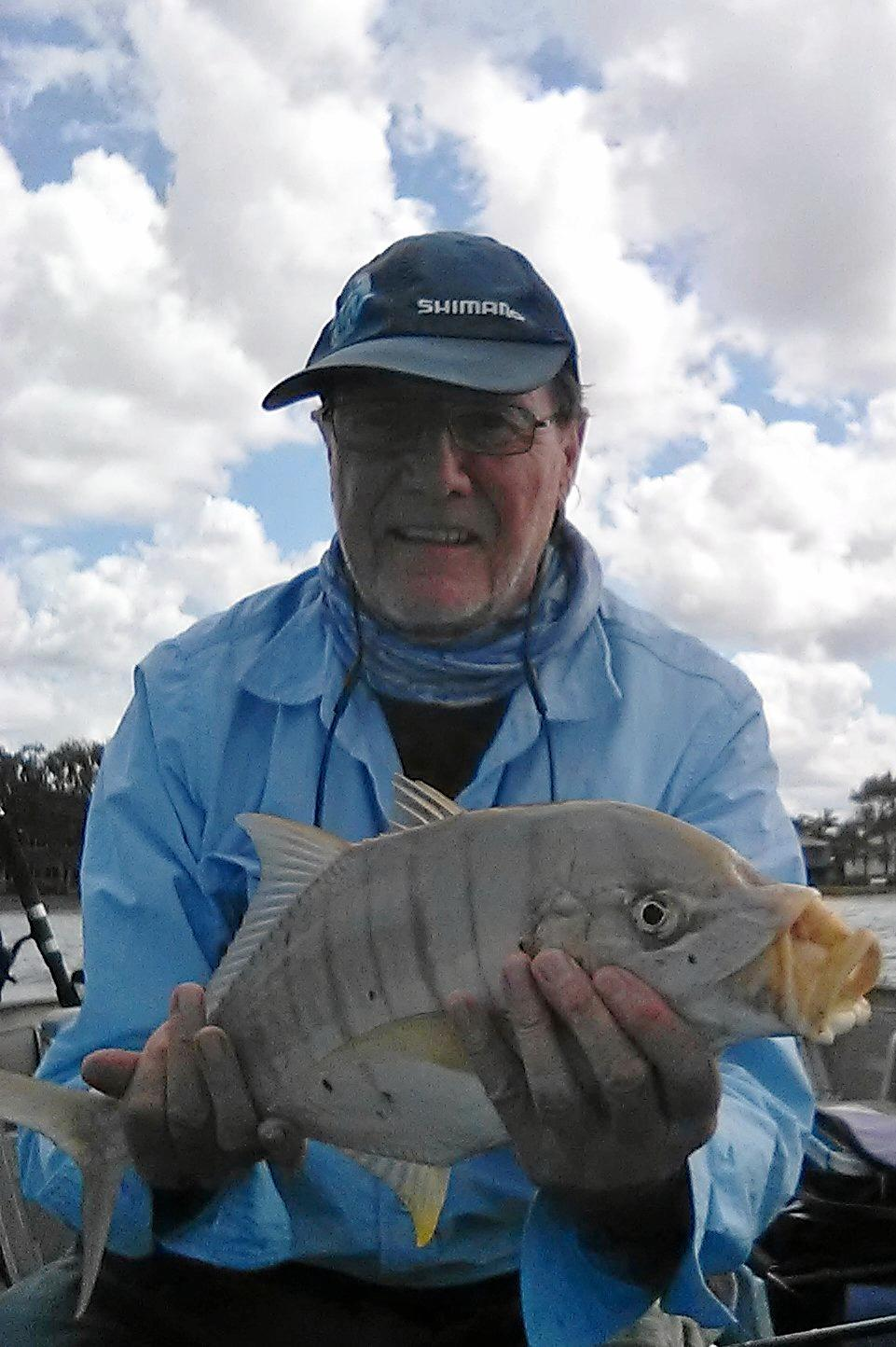 Bill Conn he caught and released this fighting golden trevally near the cod hole.
