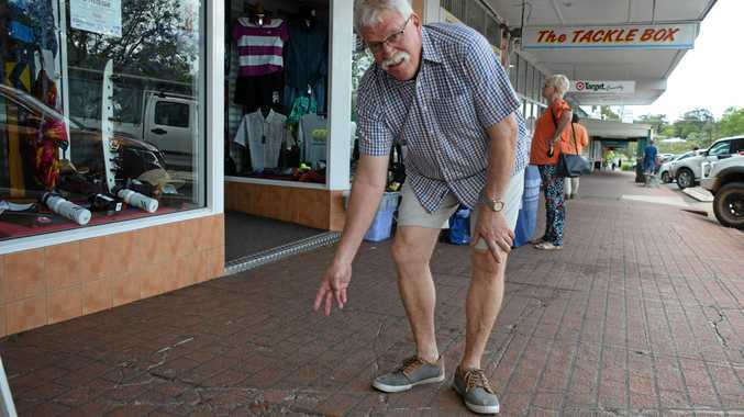 CRACKED UP: Murgon business owner, Mark Smith points out the footpath cracks.