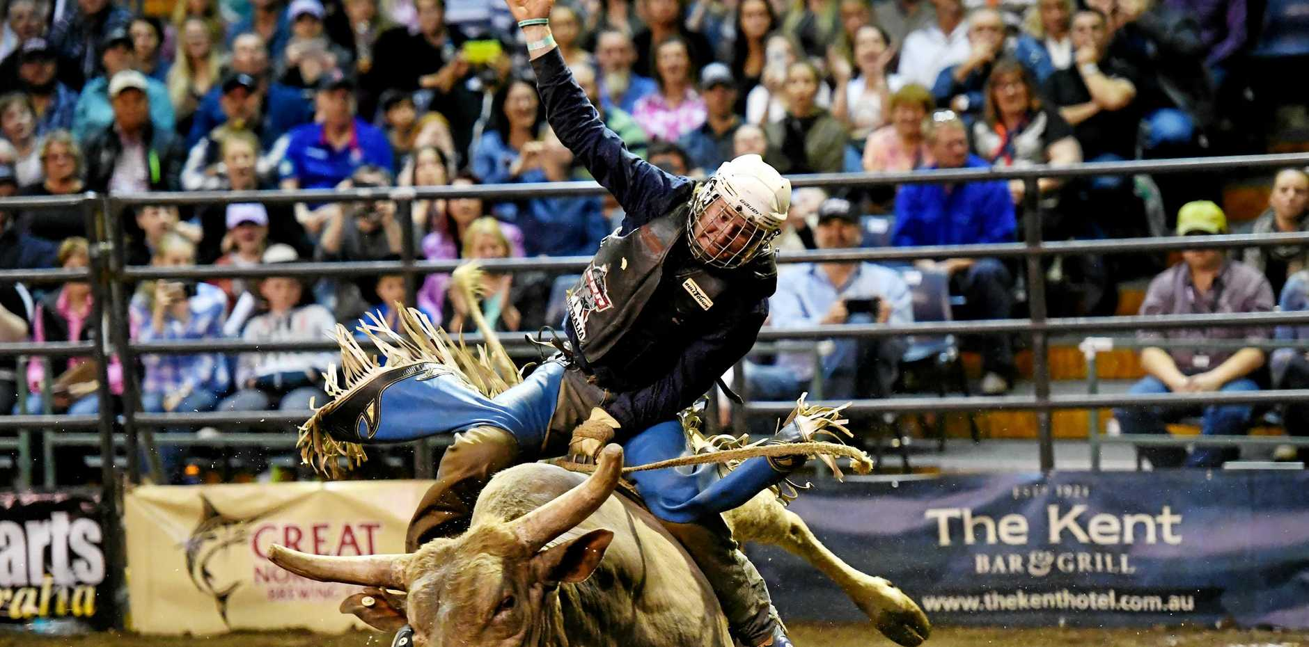 STRONG HOLD: Aaron Kleier on Sweetpro Hillbilly Deluxe for 88 points in the championship round at the Professional Bull Riders Newcastle Invitational held at the Newcastle Entertainment Centre.