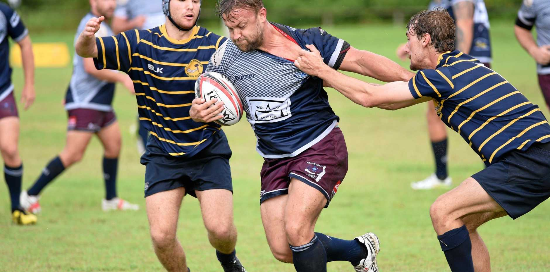 Rugby union - Fraser Coast Mariners v Gympie Hammers. Trent Devere muscles his way through the Gympie defence.