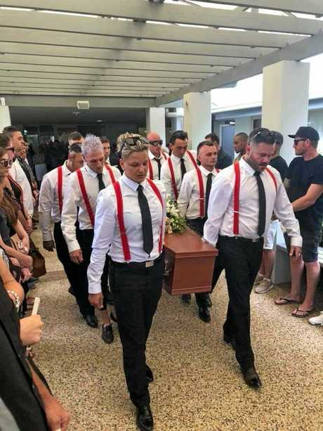 The pallbearers for Kody Davies' funeral., led by Mitch.