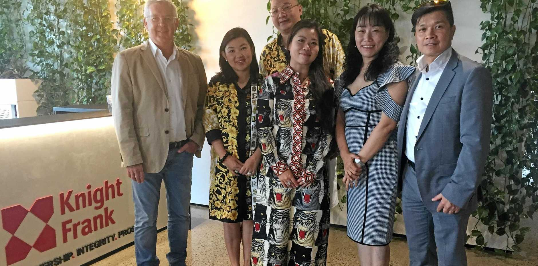 DEAL MAKERS: Rockhampton real estate agent, Pat O'Driscoll, Isabella and CK Wei, Phileen Pang, Candy Yuan and Andy Tsang at the Knight Frank office in Brisbane this week.