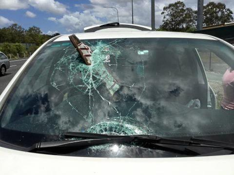 CLOSE CALL: A number plate pierced a woman's windscreen.