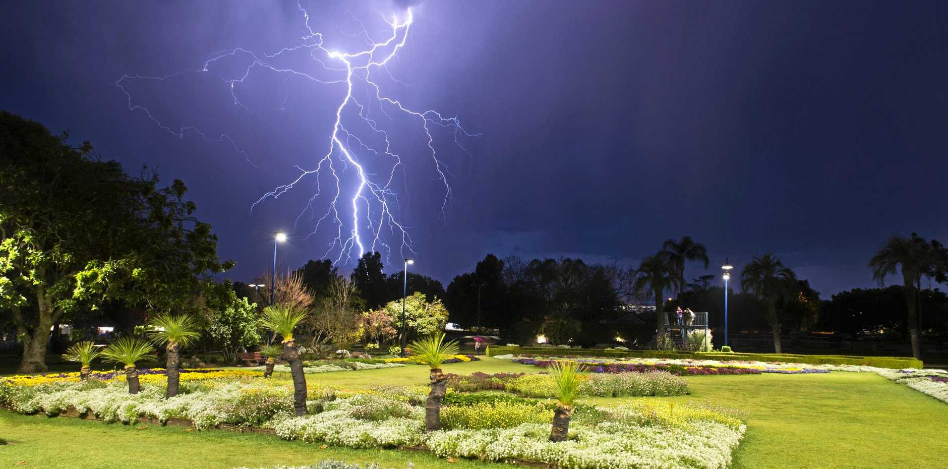 DIRECT STRIKE: Lightning is seen over Laurel Bank Park as Toowoomba prepares for the Carnival of Flowers.