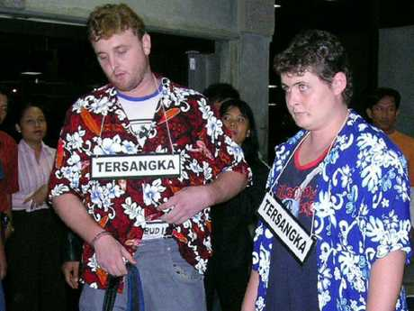Martin Stephens and Renae Lawrence wore signs marked suspect in a 2005 re-enactment of their heroin smuggling attempt. Picture: Lukman S Bintoro