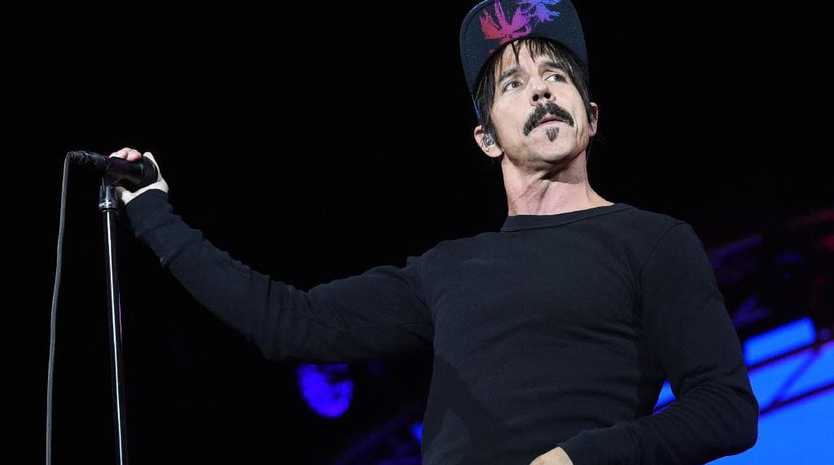 The Red Hot Chili Peppers, fronted by Anthony Kiedis, will tour Australia next year. Picture: AFP