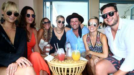 Karl and Jasmine (centre) with Jade Yarbrough (left) and friends at the luxury Rae's resort at Wategos Beach, Byron Bay.