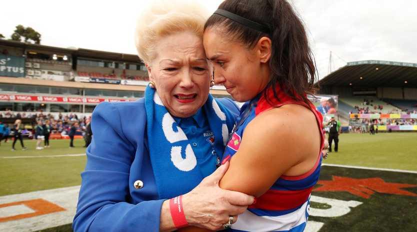 Susan Alberti celebrates the Western Bulldogs AFLW premiership with Nicole Callinan.