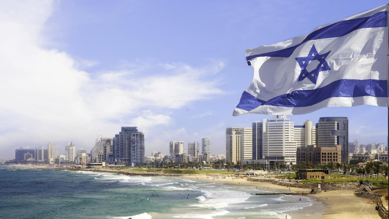 Israel's flag flies over a beach in Tel Aviv, where the Australian embassy is situated.