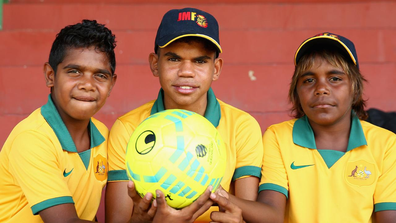 Northern Territory footballers from the John Moriarty Football team attend a Australian Socceroos training session. Picture: Getty