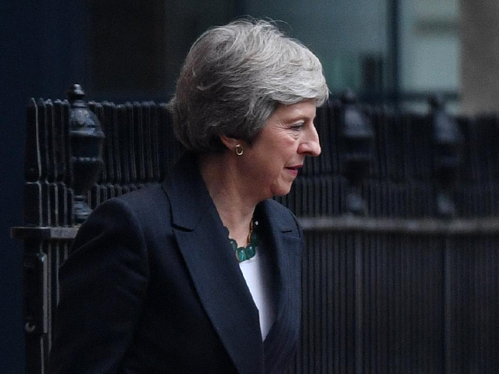 British Prime Minister Theresa May leaves Number 10 Downing Street through the back door before heading to the House of Commons.