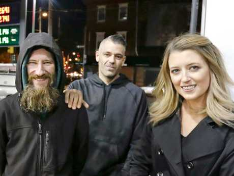 Johnny Bobbitt Jr., left, Kate McClure, right, and McClure's boyfriend Mark D'Amico pose at a Citgo station in Philadelphia. Picture: AP
