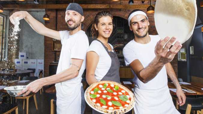 Maurizio Lachella, Monica Andreoli and Riccardo Angelini put the love into making their iconic Woodfired Pizzas at Julius in South Brisbane. Picture: Lachie Millard