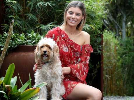 Paris Vougdis, 21, pictured with her dog Charlie, is looking for a Greek Orthodox man to date. Picture: David Swift