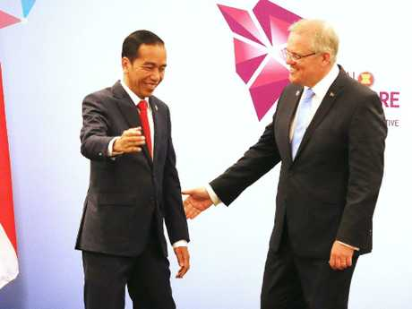 ustralian Prime Minister Scott Morrison with Indonesian President Joko Widodo at the ASEAN summit in Singapore