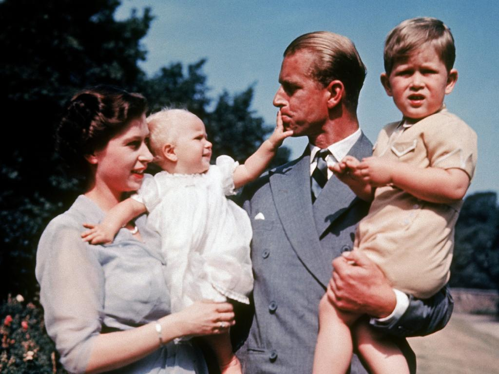 The first colour photograph of Princess Anne, taken in 1951, in the arms of her mother Queen Elizabeth II while her father, Philip, holds her brother Prince Charles. Picture: Keystone-France/Gamma-Keystone via Getty