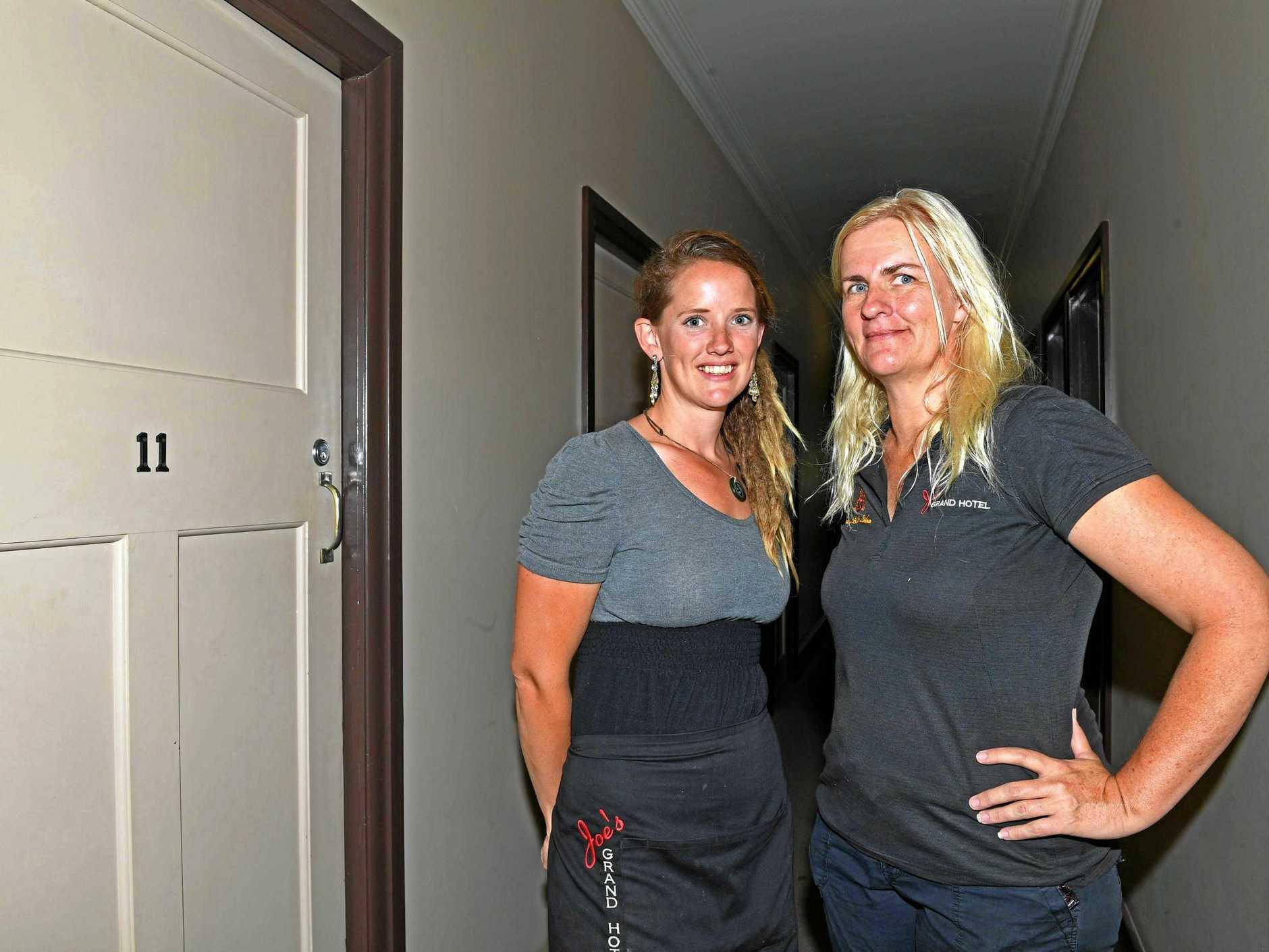Emma Lucas and Sally Detlefson outside Room 11 of Joe's Grand Hotel in Goomeri.