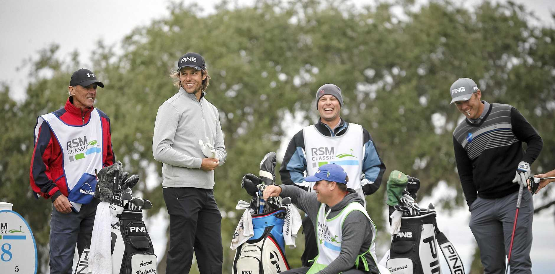 Aaron Baddeley, second from the left, jokes with a group of caddies and Seamus Power, of Ireland, right, on the eighth tee at the RSM Classic. Picture: Stephen B Morton/AP