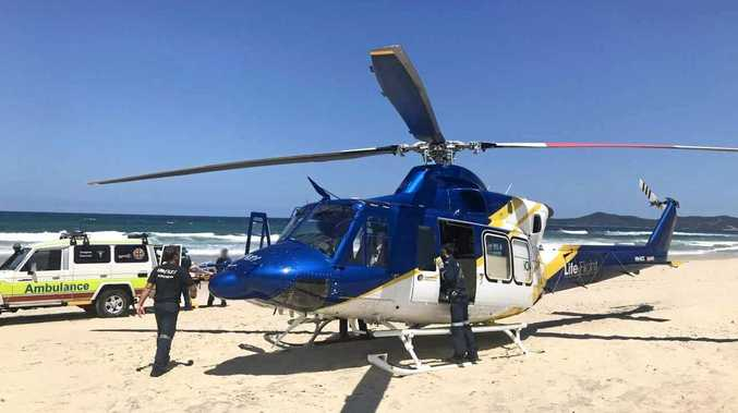 Schoolie flown to hospital after near-drowning at beach