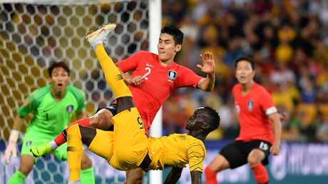 Awer Mabil (center) of the Socceroos does an over head kick