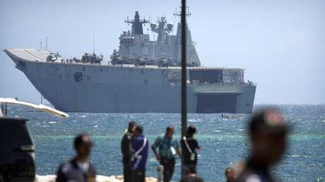 Australian naval ship HMAS Adelaide is anchored just offshore in Port Moresby. Australia is spending millions on security measures for the APEC summit in Papua New Guinea. Picture: Mark Schiefelbein/AP