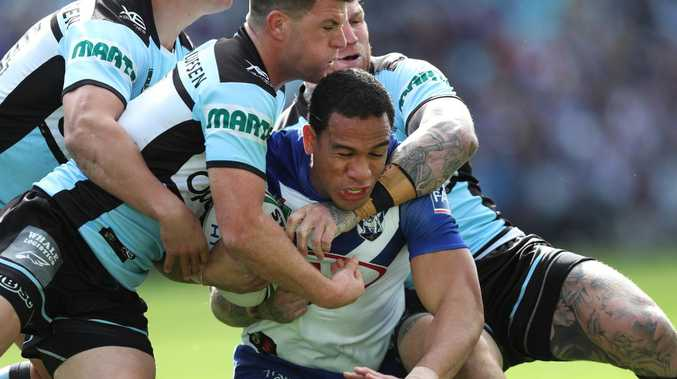 Will Hopoate is tackled in a game against the Sharks. Picture: Brett Costello