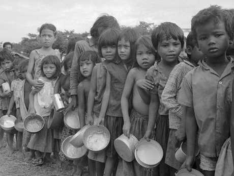 In this photo taken in January 1975, Cambodian refugee children wait their turn at a relief organisation feeding station northwest of Phnom Penh, Cambodia. Picture: AP