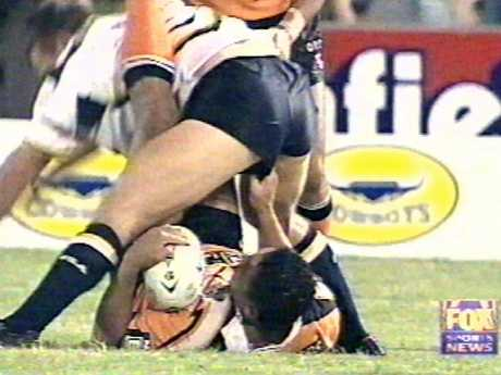 John Hopoate (bottom) interferes with an opponent.