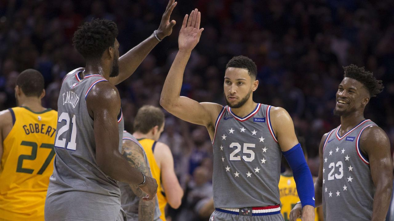 The 76ers' Joel Embiid, Ben Simmons and Jimmy Butler celebrate in front of Rudy Gobert of the Utah Jazz during a timeout in the fourth quarter. Picture: Mitchell Leff/Getty Images