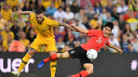 Josh Risdon (left) of the Socceroos in action against Na Sangho (right) of Korea Republic