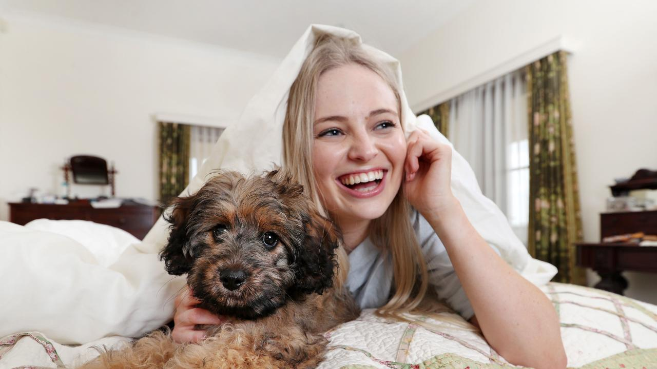 Georgia Taylor, 21, keeps her cavoodle Lucy inside during storms. Picture: Tara Croser