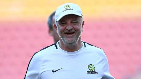 Graham Arnold is enjoying himself in his dream job.