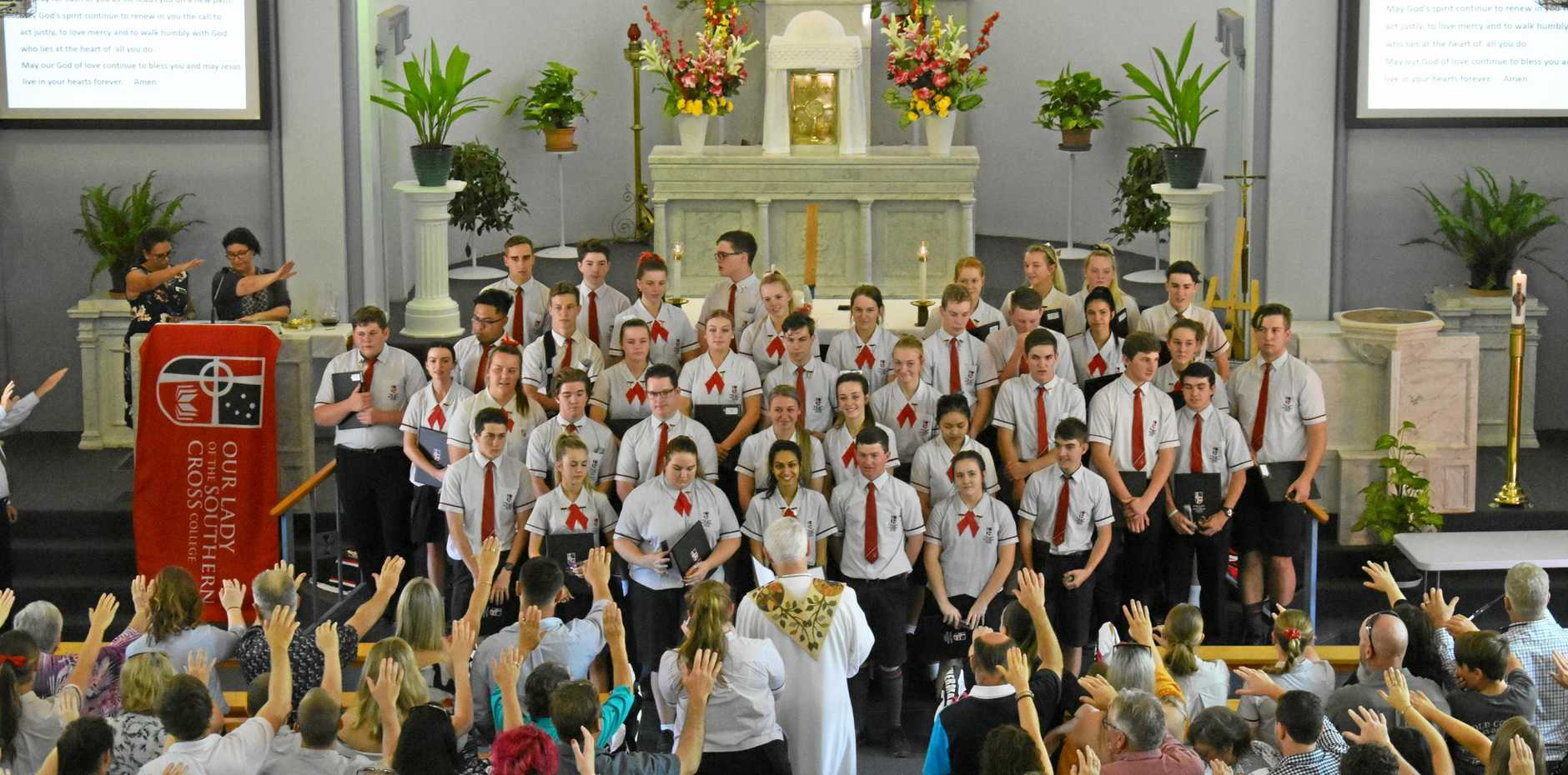 Students from Our Lady of the Southern Cross College graduate at St Jospeh's Catholic Church, 2018