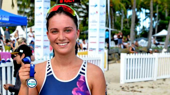Triathlete Brianna Thomas celebrates after taking out the women's section of the Hamilton Island Triathlon on Saturday.