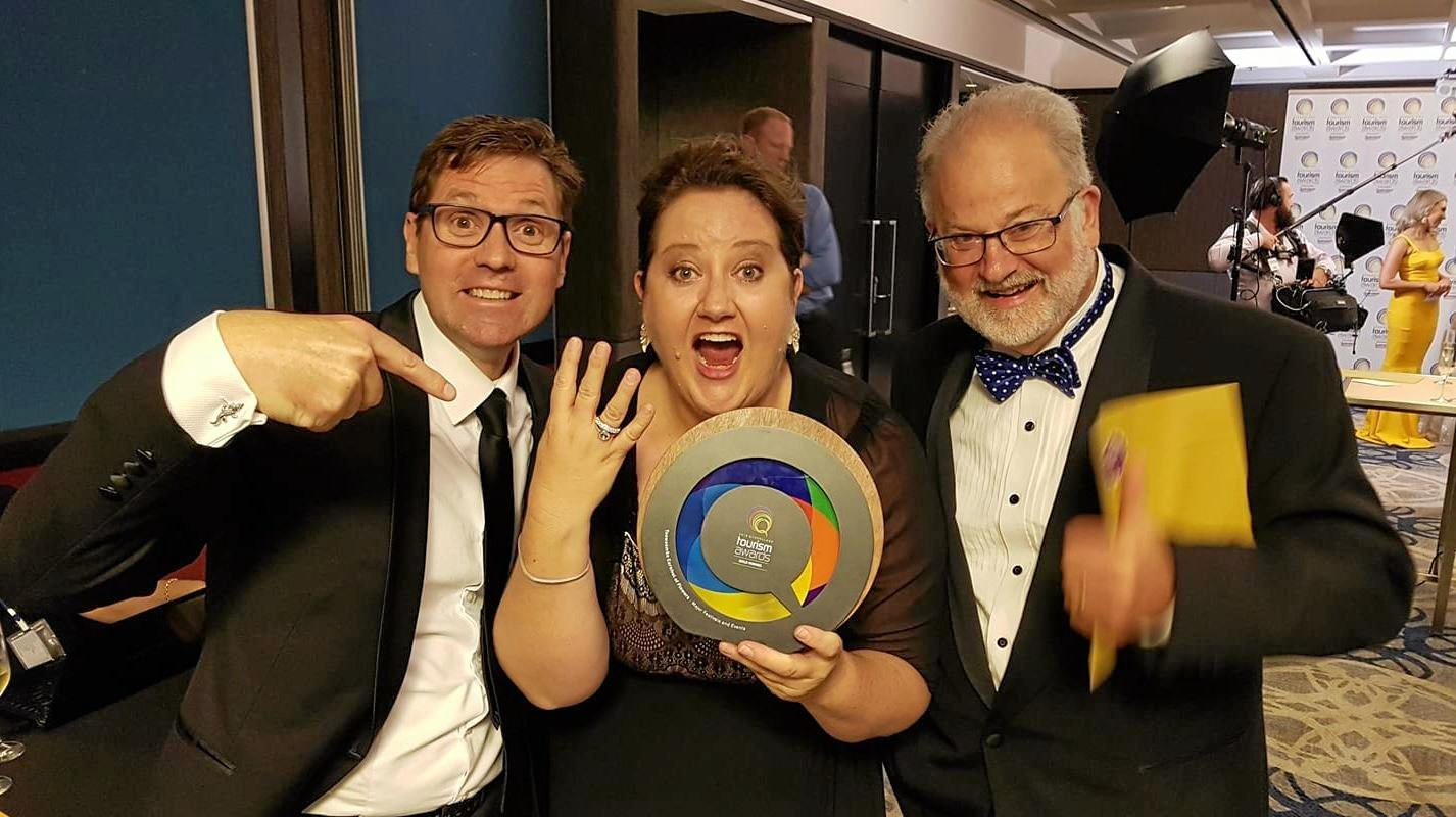 Cr Geoff McDonald, Kate Scott and Ross Begent celebrating the Carnival of Flowers' fourth win at the Queensland Tourism Awards last night.
