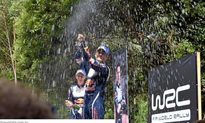 Sebastien Ogier sprays to a sixth World Rally Championship title on the Coffs Coast.