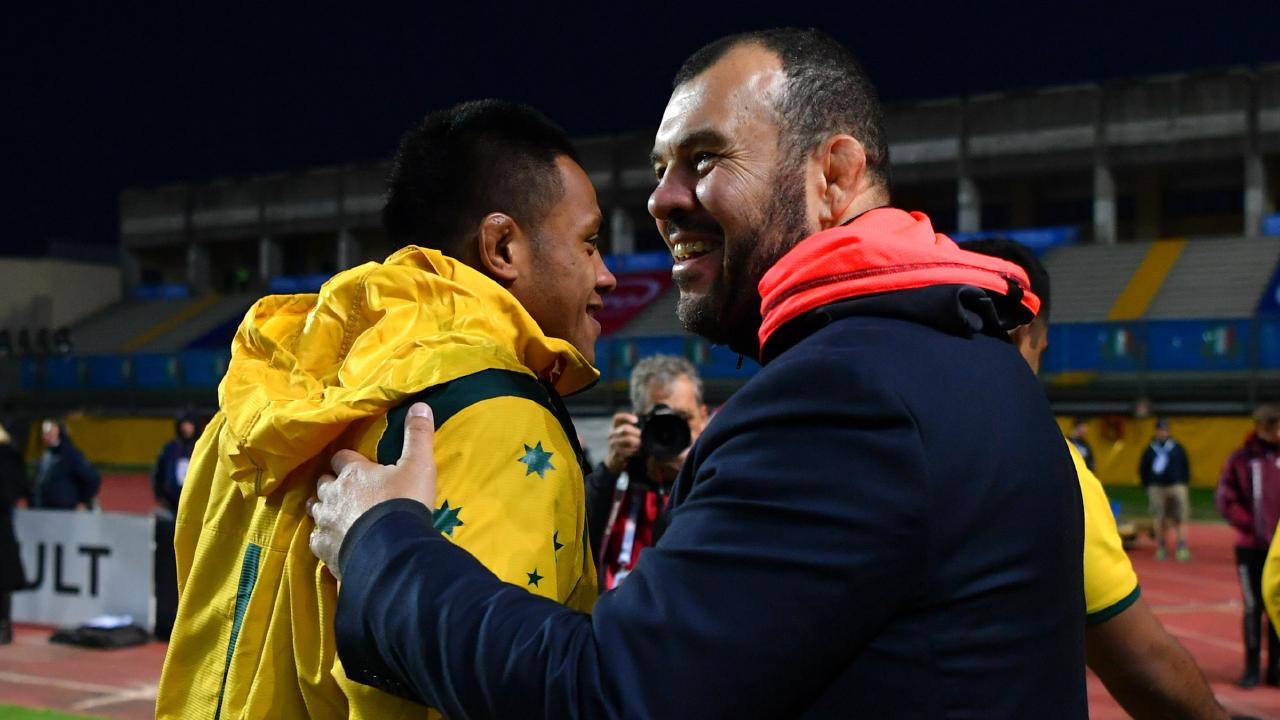 Winners are grinners: Wallabies coach Michael Cheika shares a laugh with prop Allan Alaalatoa. Picture: Getty
