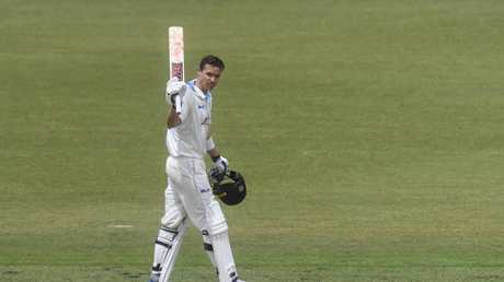 Nick Larkin of the Blues celebrates after reaching his century