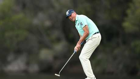 Matt Kuchar of the United States putts on the 1st green