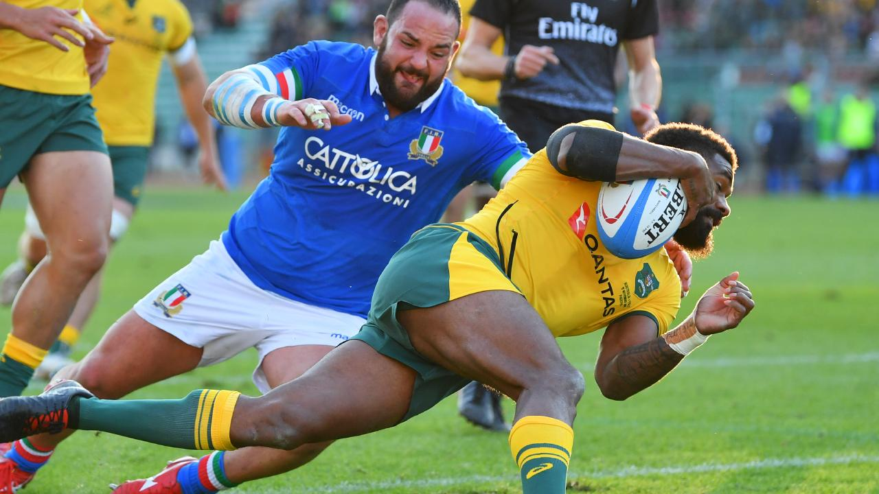 Marika Koroibete of Australia crosses to score their second try during the international friendly between Italy and Australia.