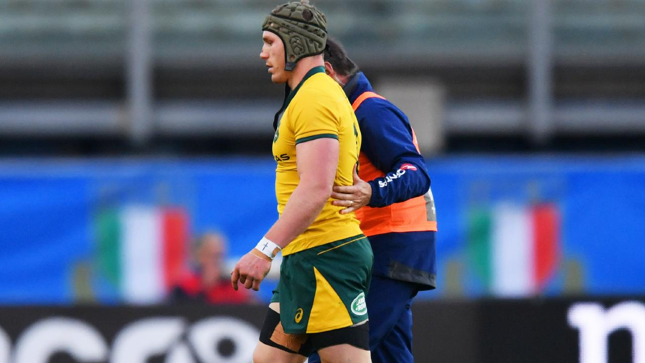David Pocock leaves the pitch with a neck injury.