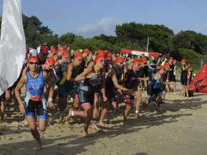 Over-40s womens charge into the water during the