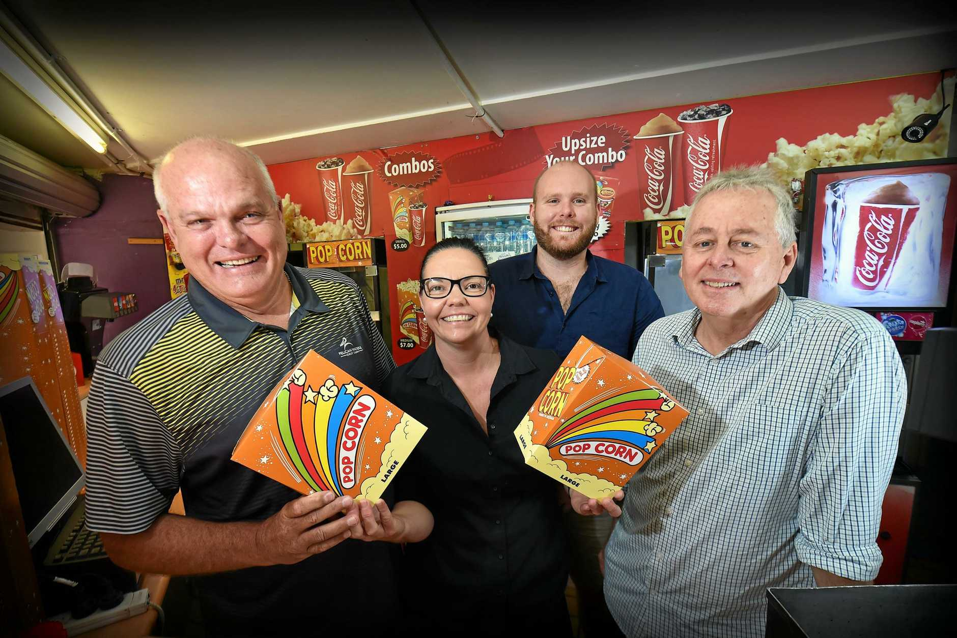 HAPPY: Owner of Big Screen Cinemas Caloundra Nick Struik (left) says the business has been thriving for 22 years, despite constant changes and new cinema developments cropping up. With Nick are Mandy McClarence, Anthony Struik and Murray Power.