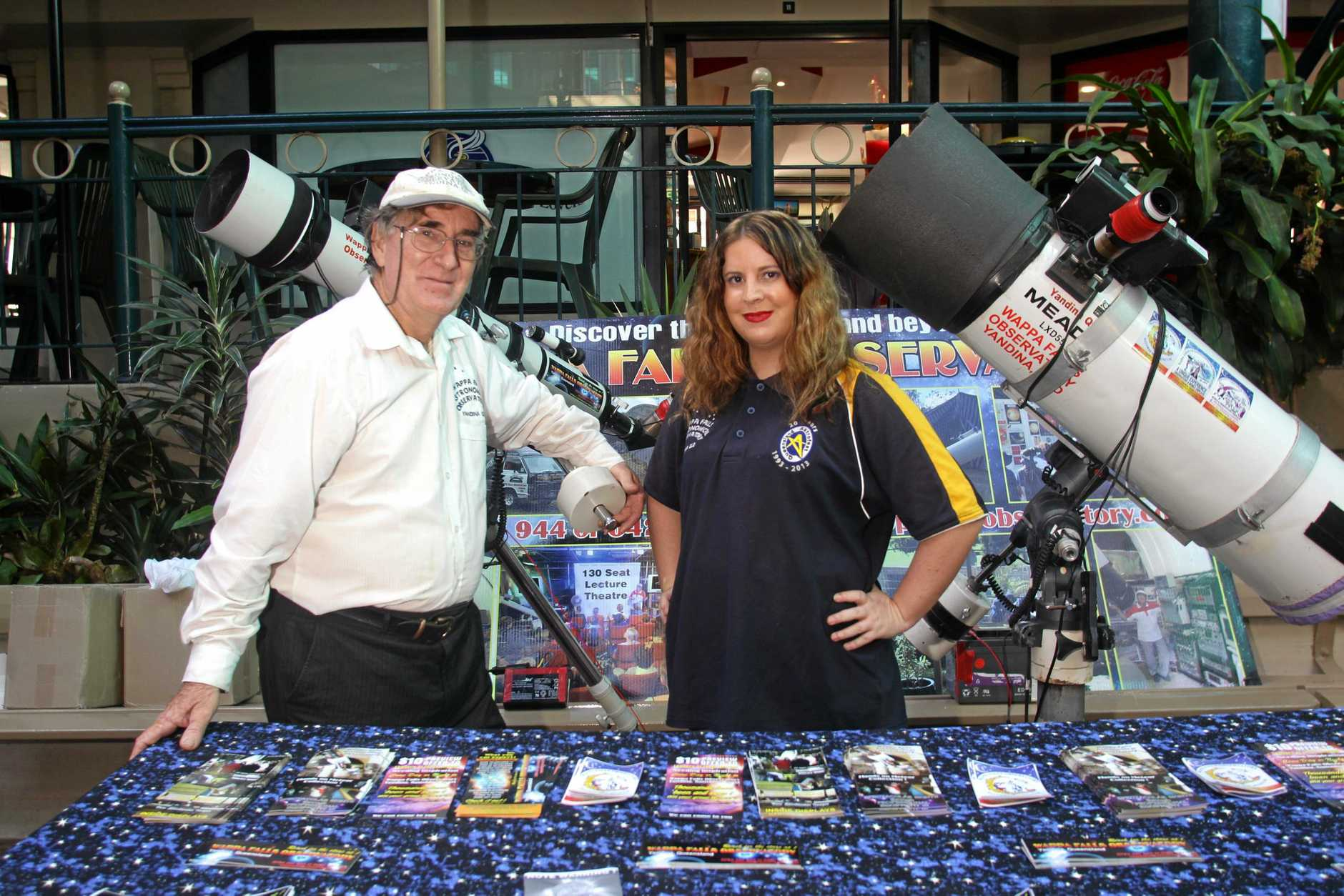 AMAZING: Owen Bennedick and his daughter Sarah from the Wappa Falls observatory at a display at the cinemas.